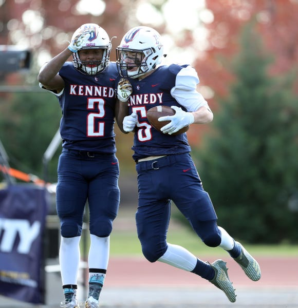 Kennedy Catholic's Tyler Outhouse (5) celebrates a touchdown with teammate Seth Surrett (2) during their 19-12 loss to Cardinal Spellman in the CHSFL Class 'A' Championship Game at Mitchel Field Complex in Uniondale on Saturday, November 17, 2018.