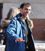 New Rochelle Mayor Noam Bramson waves  to the crowd during the New Rochelle 55th Annual Thanksgiving Parade along North Avenue in the city, Nov. 17, 2018.