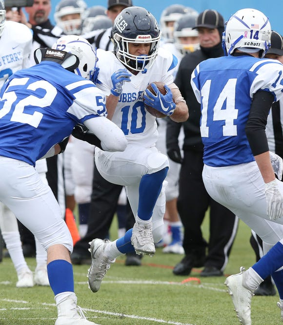 Dobbs Ferry's Emilio Nolasco (10) jumps for some extra yardage against Ogdensburg during the state Class C semifinal game at Middletown High School Nov. 17, 2018.