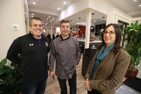 Lohud food reporter Jeanne Muchnick with, far left, Joe  Longobardo and his brother, Anthony at the new Joe & Joe in Nyack.