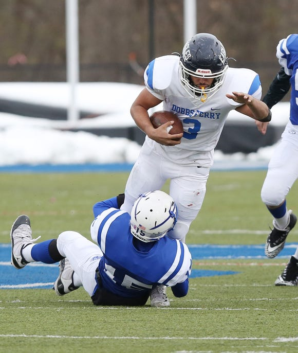 Dobbs Ferry's Awvise Khan (3) tries to break away from Ogdensburg's Mesean Johnson (15) during the state Class C semifinal game at Middletown High School Nov. 17, 2018.