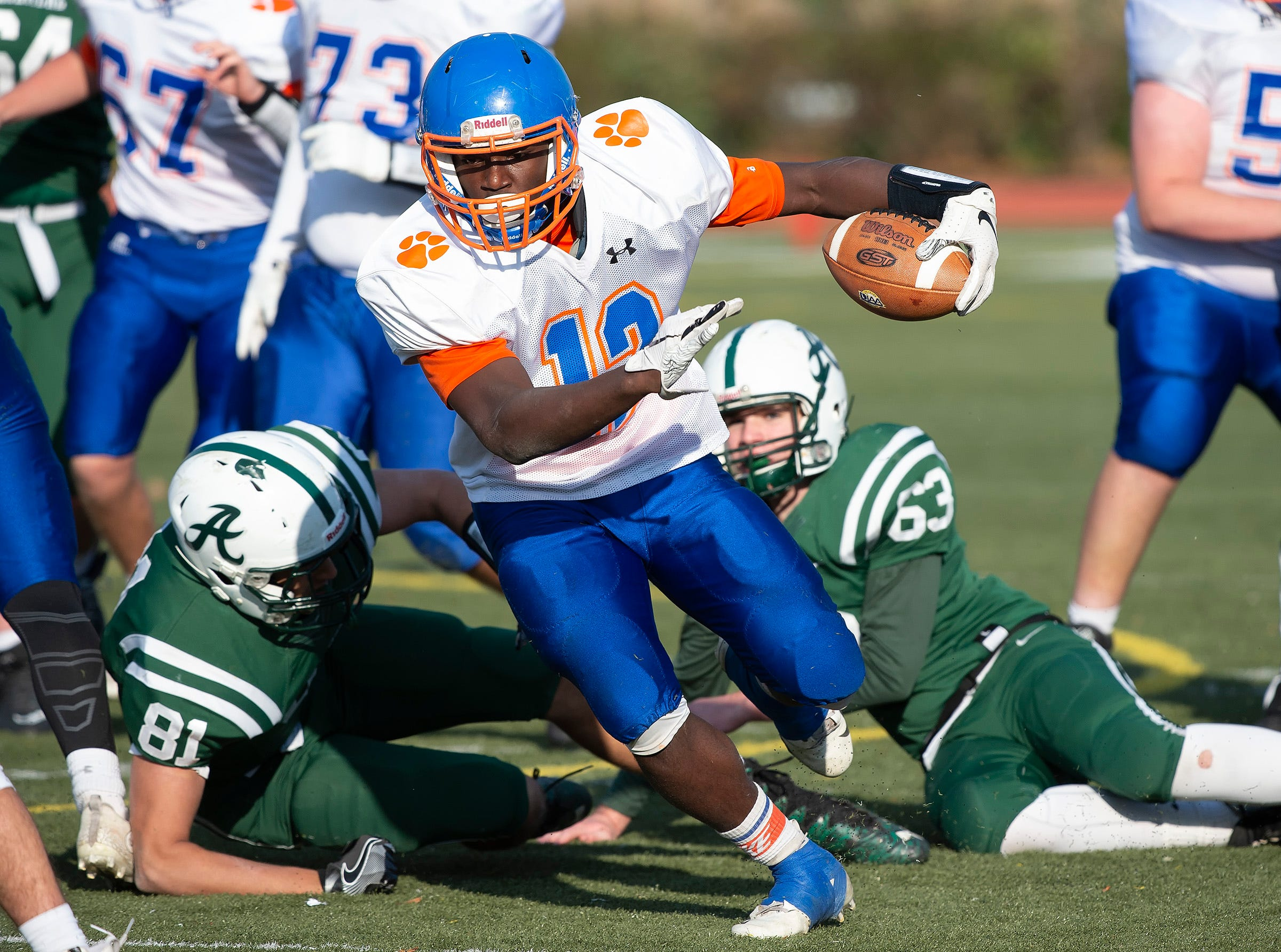 Delmar's Te'Shawn Dennard (12) breaks tackle attempt in their 38-10 playoff win against Archmere.