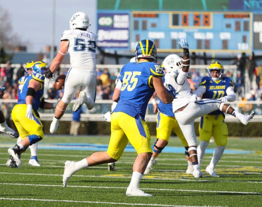 Villanova linebacker Drew Wiley (52) intercepts a fourth-down pass intended for Delaware tight end Charles Scarff late in the second quarter at Delaware Stadium Saturday.