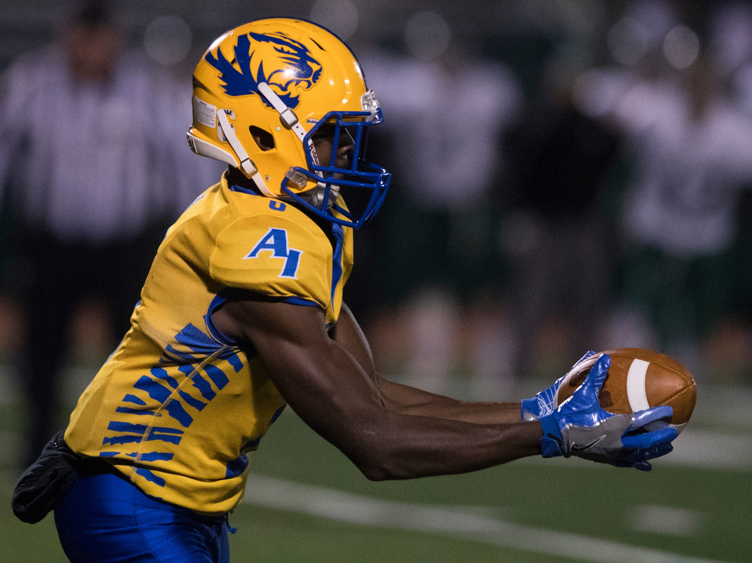 A.I du Pont's LeRoy Lynch makes a reception Friday night against Tower Hill. Tower Hill defeated A.I. du Pont 22-14.