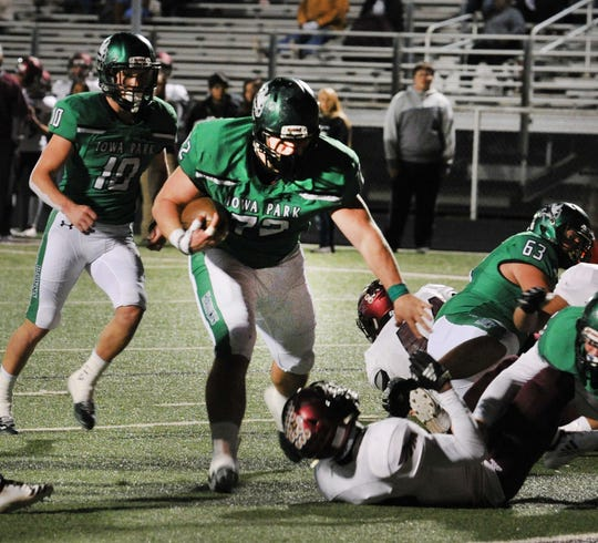 Iowa Park Hawk's Jeremiah Stanley runs in for a touchdown, Friday night in their game against the Hillsboro Burros in Bridgeport.