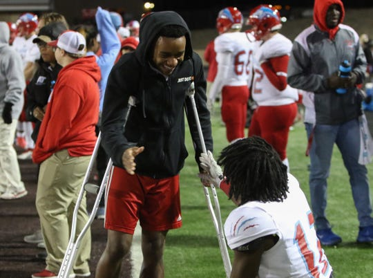 Hirschi's Nate Downing talks with Stavonte Vaughn on the sideline Friday, Nov. 16, 2018, in the Region I-4A bi-district game against Pampa in Vernon.