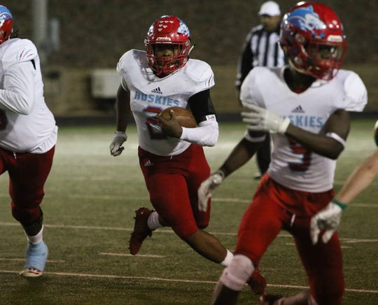 Hirschi's Fred Fleeks runs thorugh the line of scrimmage against Pampa Friday, Nov. 16, 2018, in the Region I-4A bi-district game in Vernon.