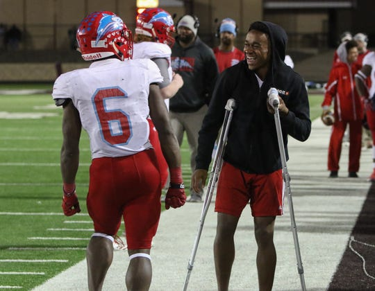 Hirschi's Daimarqua Foster, left, stops to celebrate his touchdown against Pampa with Nate Downing Friday, Nov. 16, 2018, in the Region I-4A bi-district game in Vernon.
