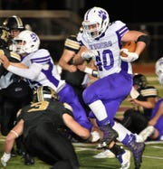 Running back Caleb Helm, pictured here in a 2018 playoff game against Henrietta, has been one of the key pieces in Jacksboro's run game