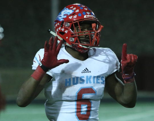 Hirschi's Daimarqua Foster holds up a six for Nate Downing after scoring a touchdown against Pampa Friday, Nov. 16, 2018, in the Region I-4A bi-district game in Vernon.