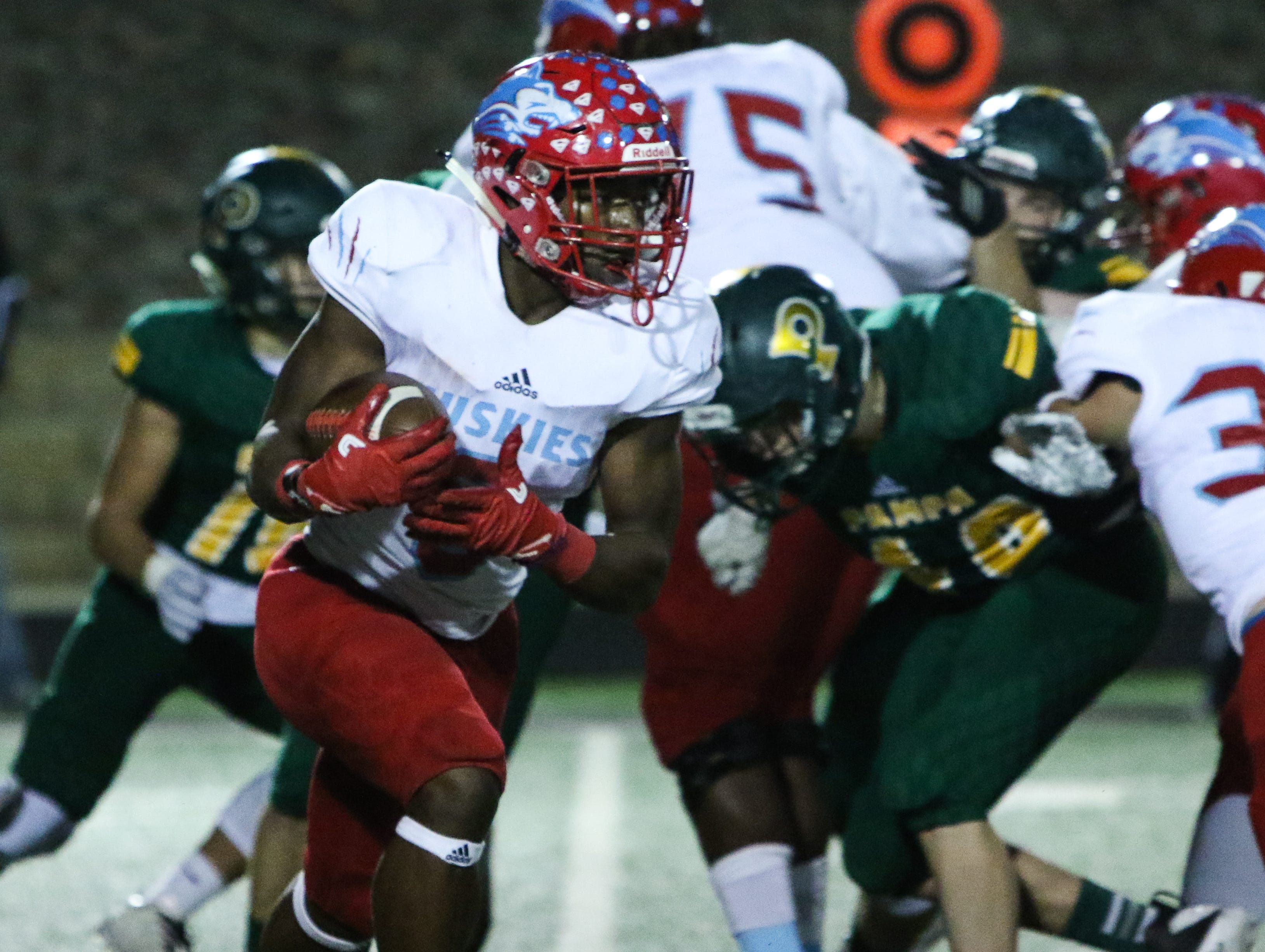 Hirschi's Daimarqua Foster runs through a hole in the line of scrimmage against Pampa Friday, Nov. 16, 2018, in the Region I-4A bi-district game in Vernon.