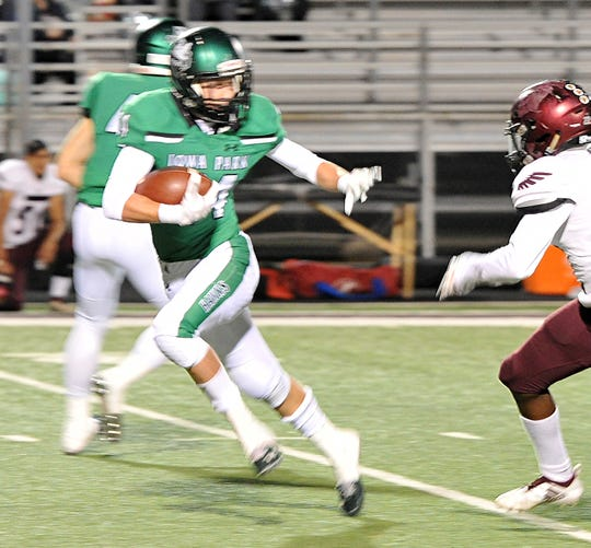 Iowa Park Hawk's Kaden Teafatiller (14) avoids a tackle during the Hawk's game against the Hillsboro Burros Friday night in Bridgeport.