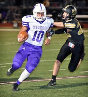 Jacksboro runningback Gio Salazar (10) shakes off a tackler during a kickoff return in the 3A Division II bi-district playoff game Friday night in Bowie.