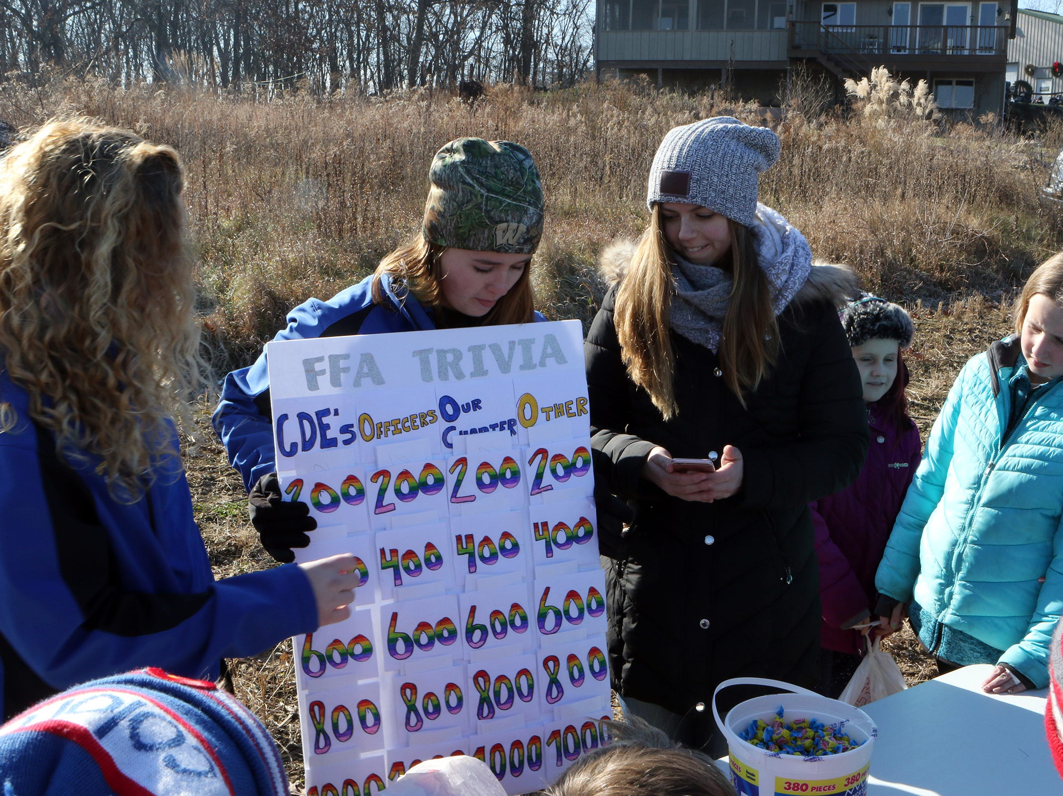 FFA members quiz fourth and fifth graders visiting Winterberry Tree Farm in Brooklyn on Nov. 15.