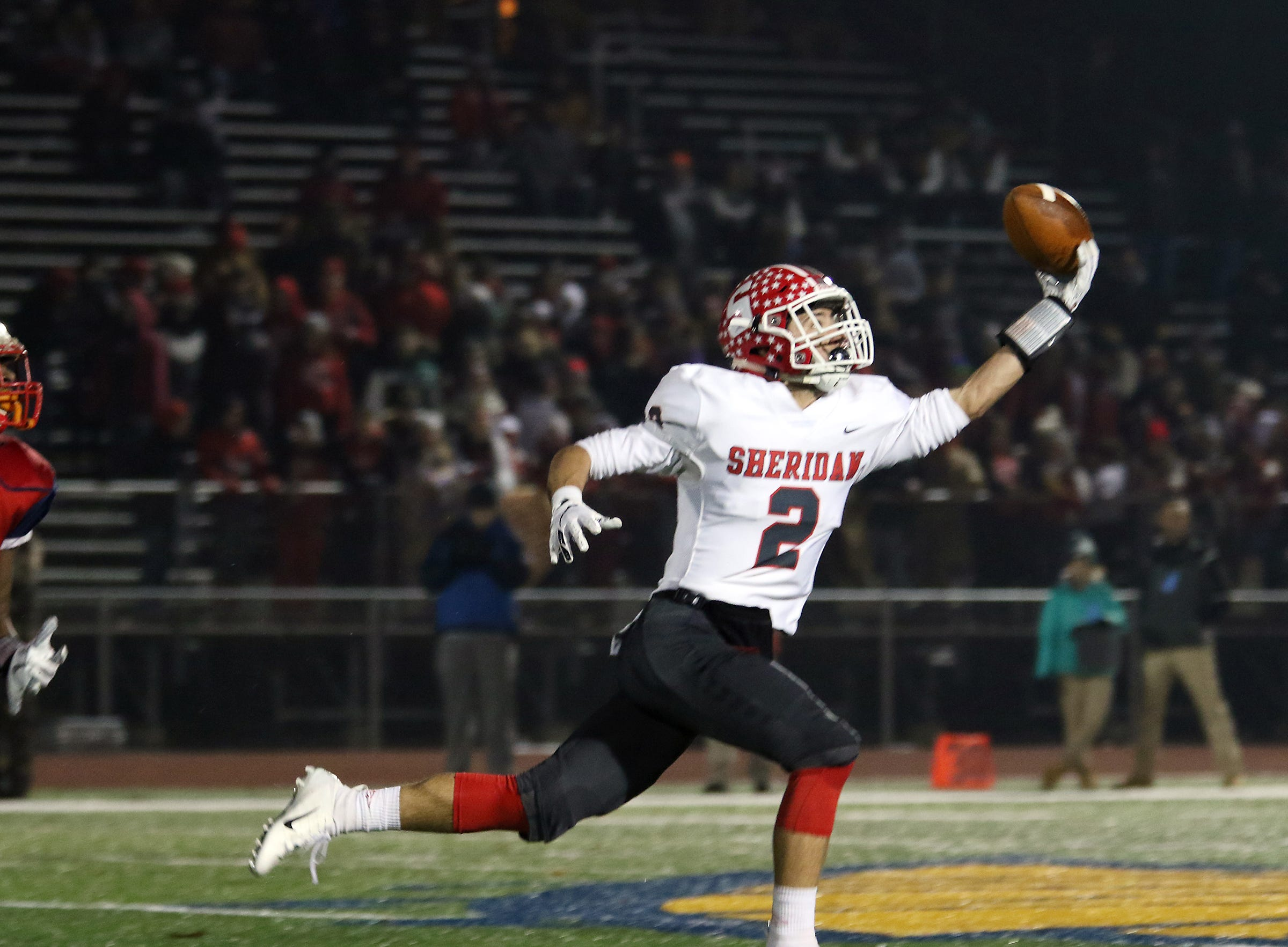 Sheridans' Cole Casto reaches for a pass against Eastmoor.