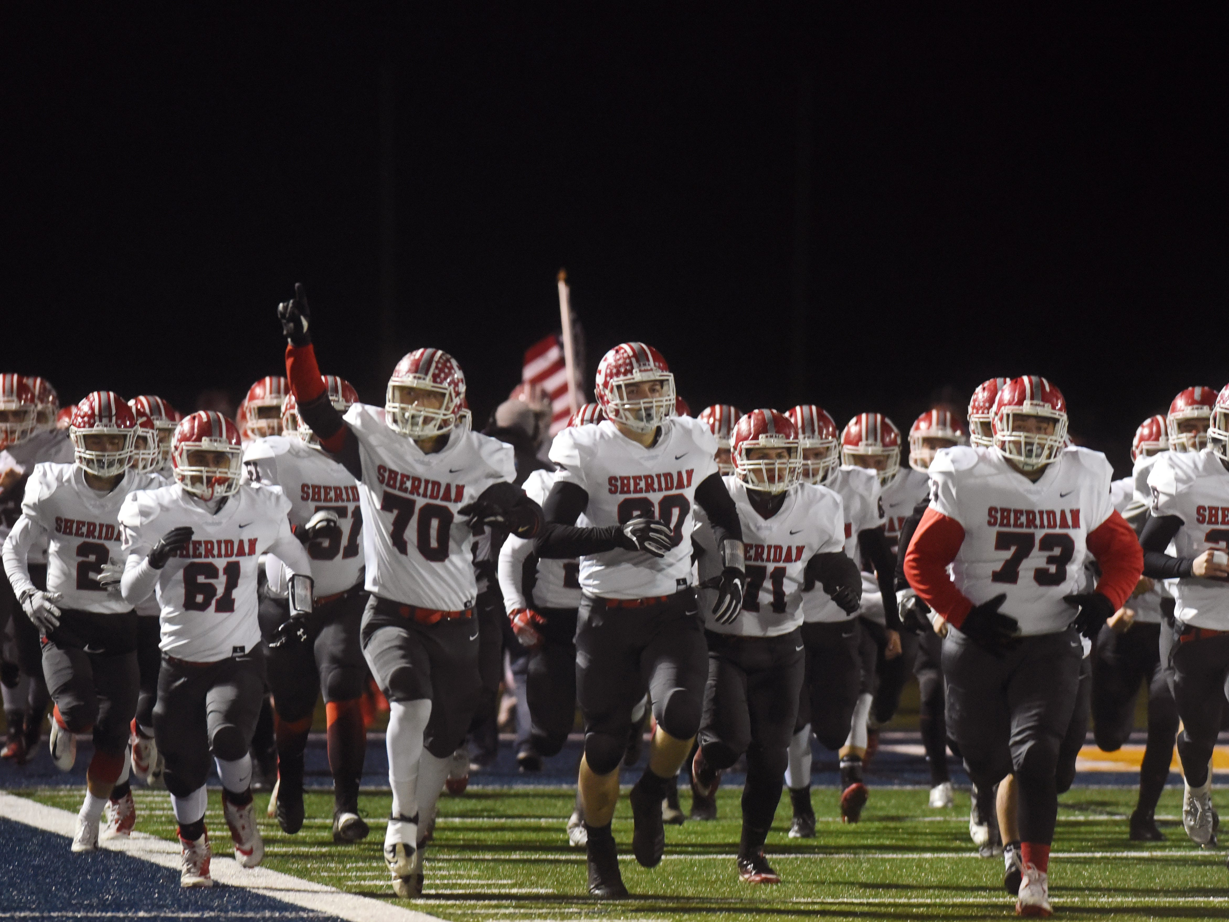 Sheridan runs on to the field prior to its 20-14 loss to Columbus Eastmoor Academy in a Division III, Region 11 final on Friday night in Lancaster.