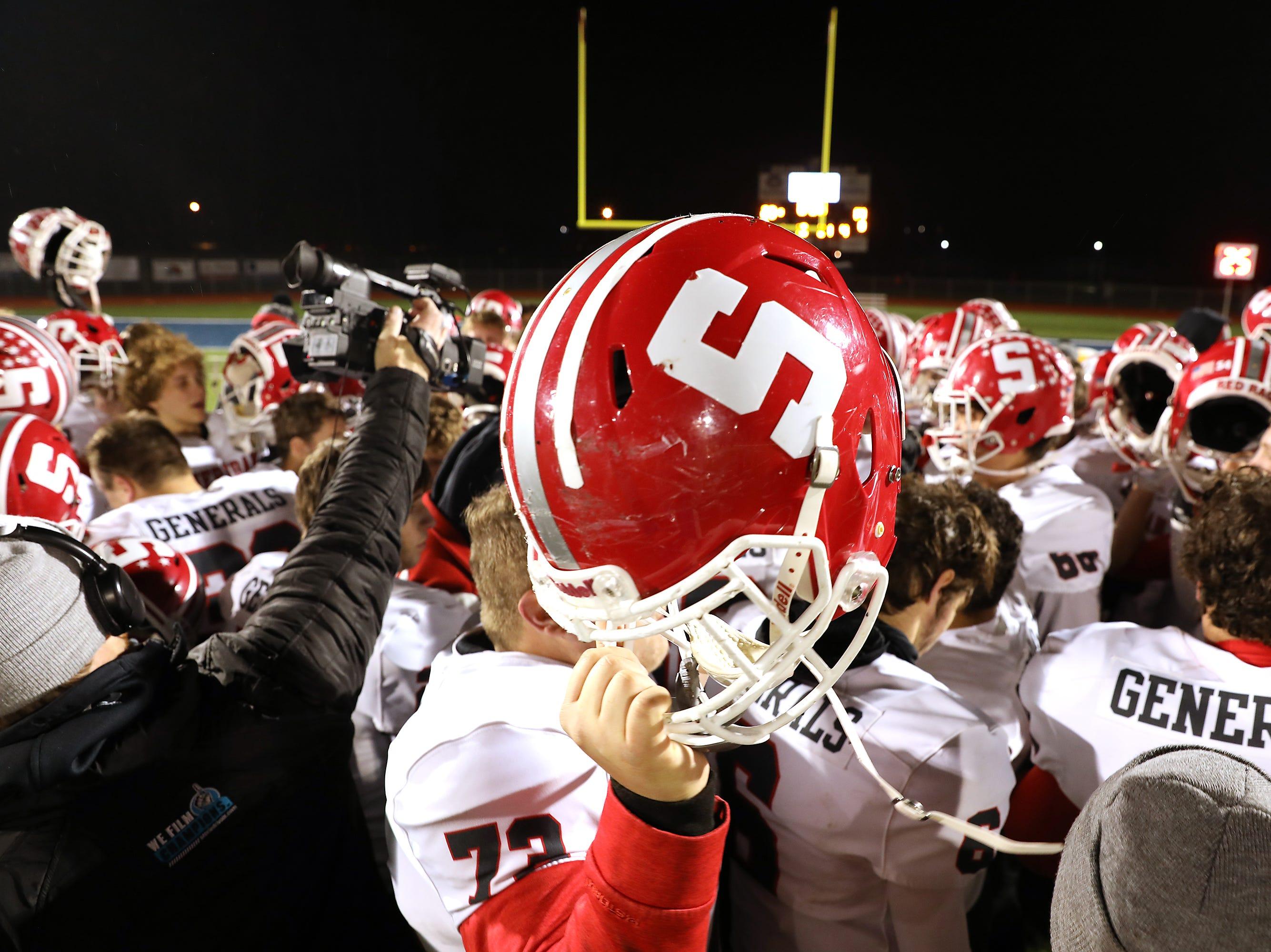 Sheridan raises their helmet one last time as their season draws to a close.