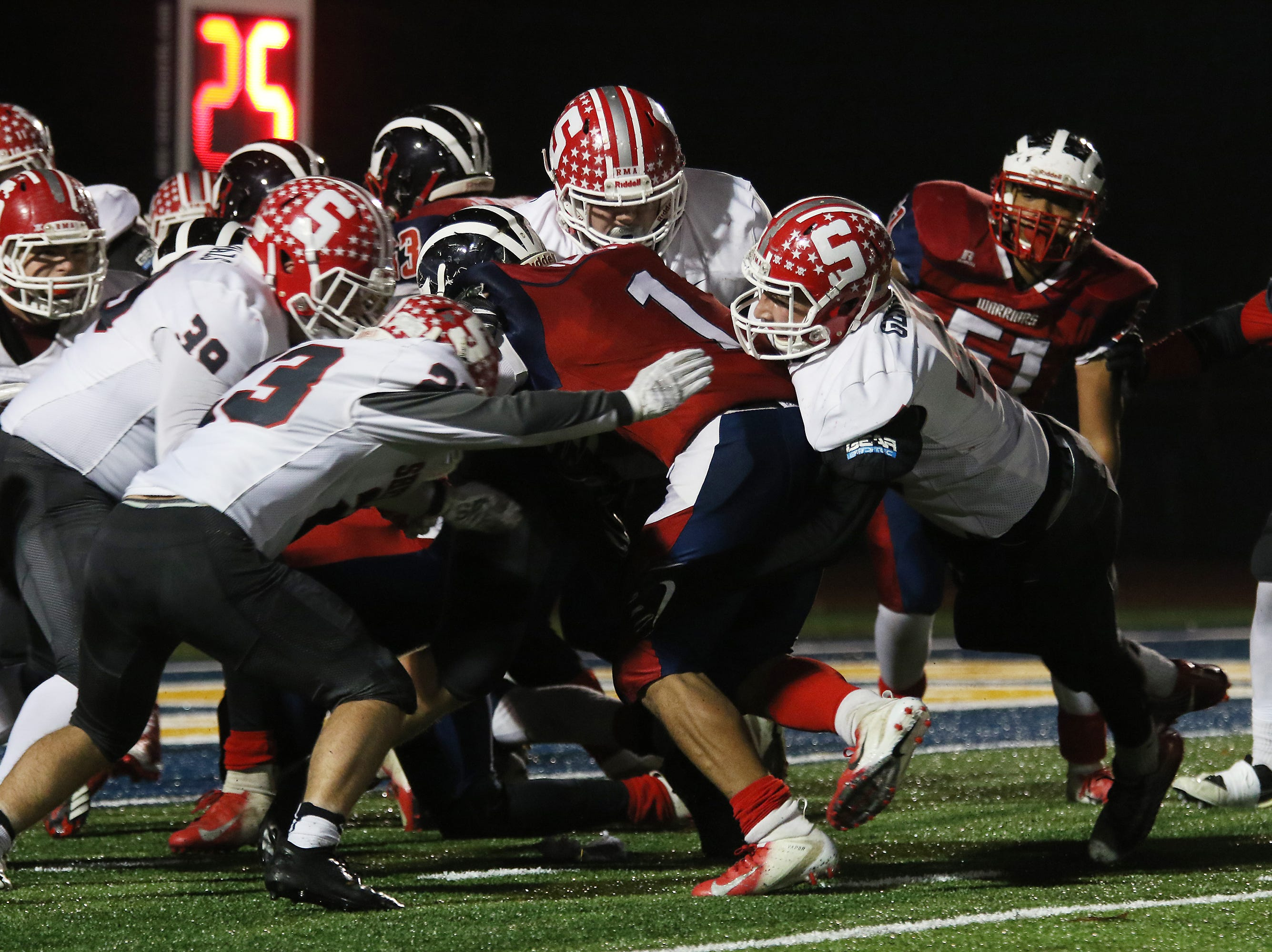 Sheridan defenders keep an Eastmoor ball carrier out of the endzone.