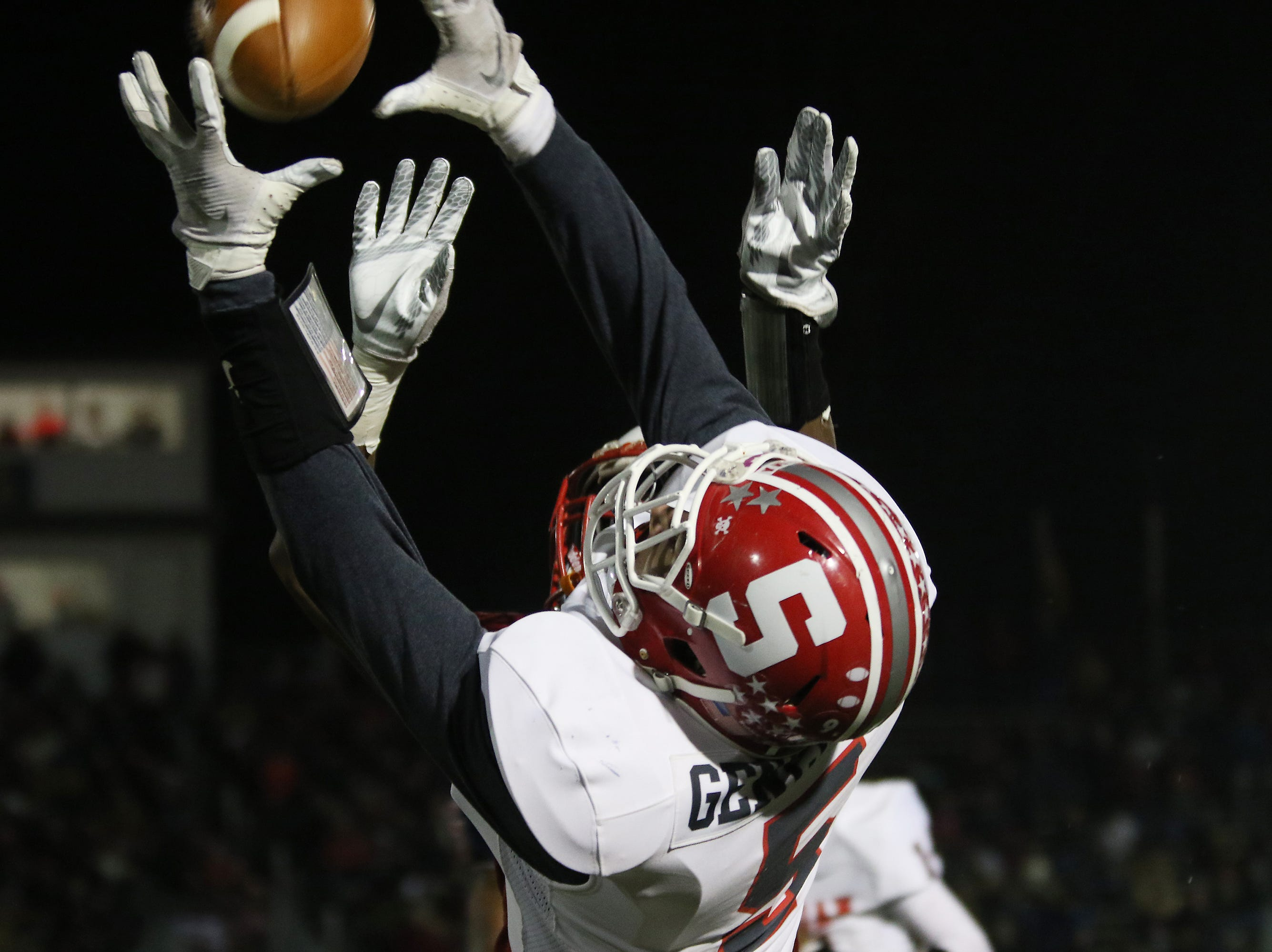 Sheridan's Shay Taylor reaches for a pass against Eastmoor.
