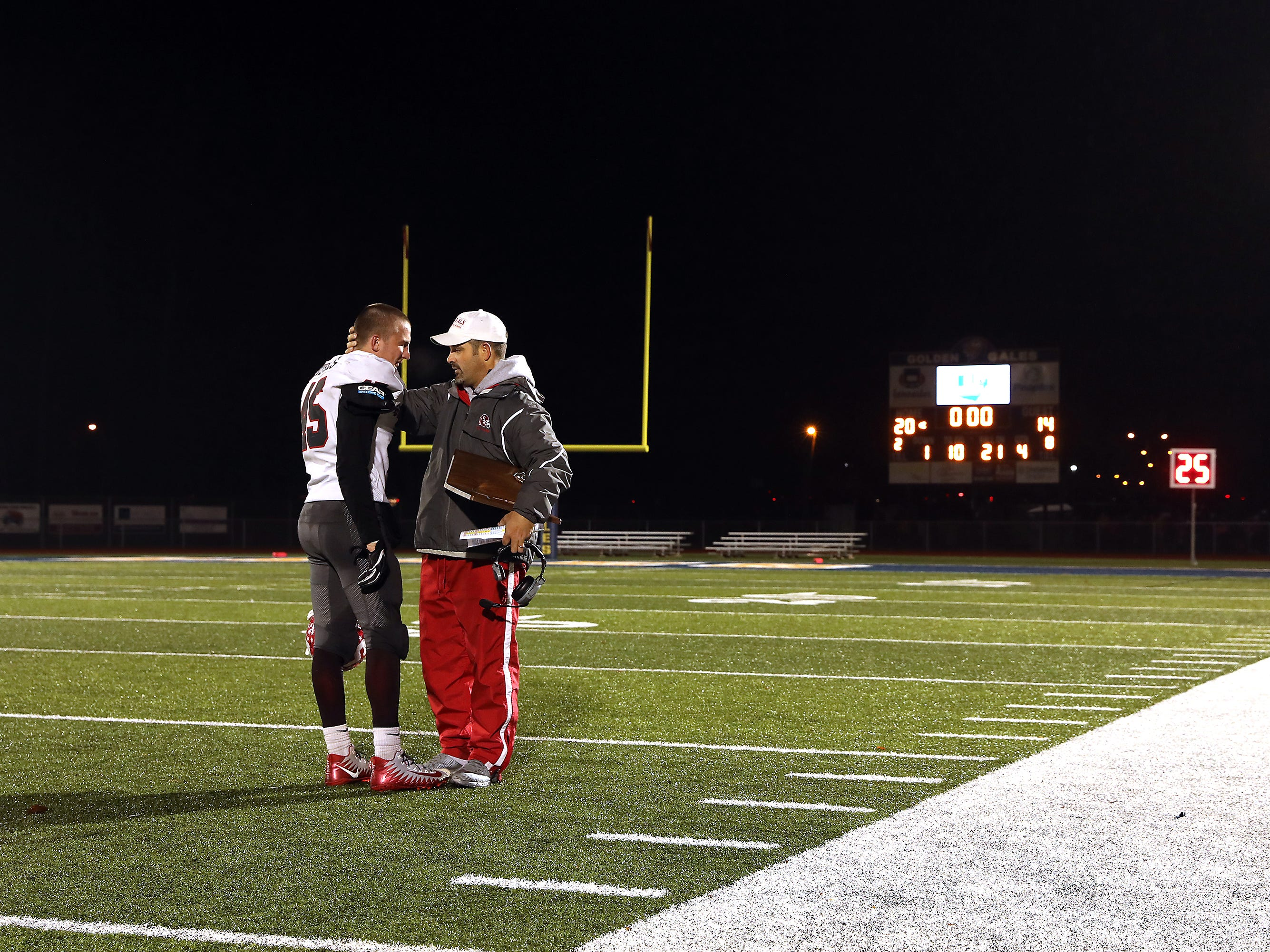 Sheridan head coach Paul Culver III talks to one of his players after the Generals fell to Eastmoor.