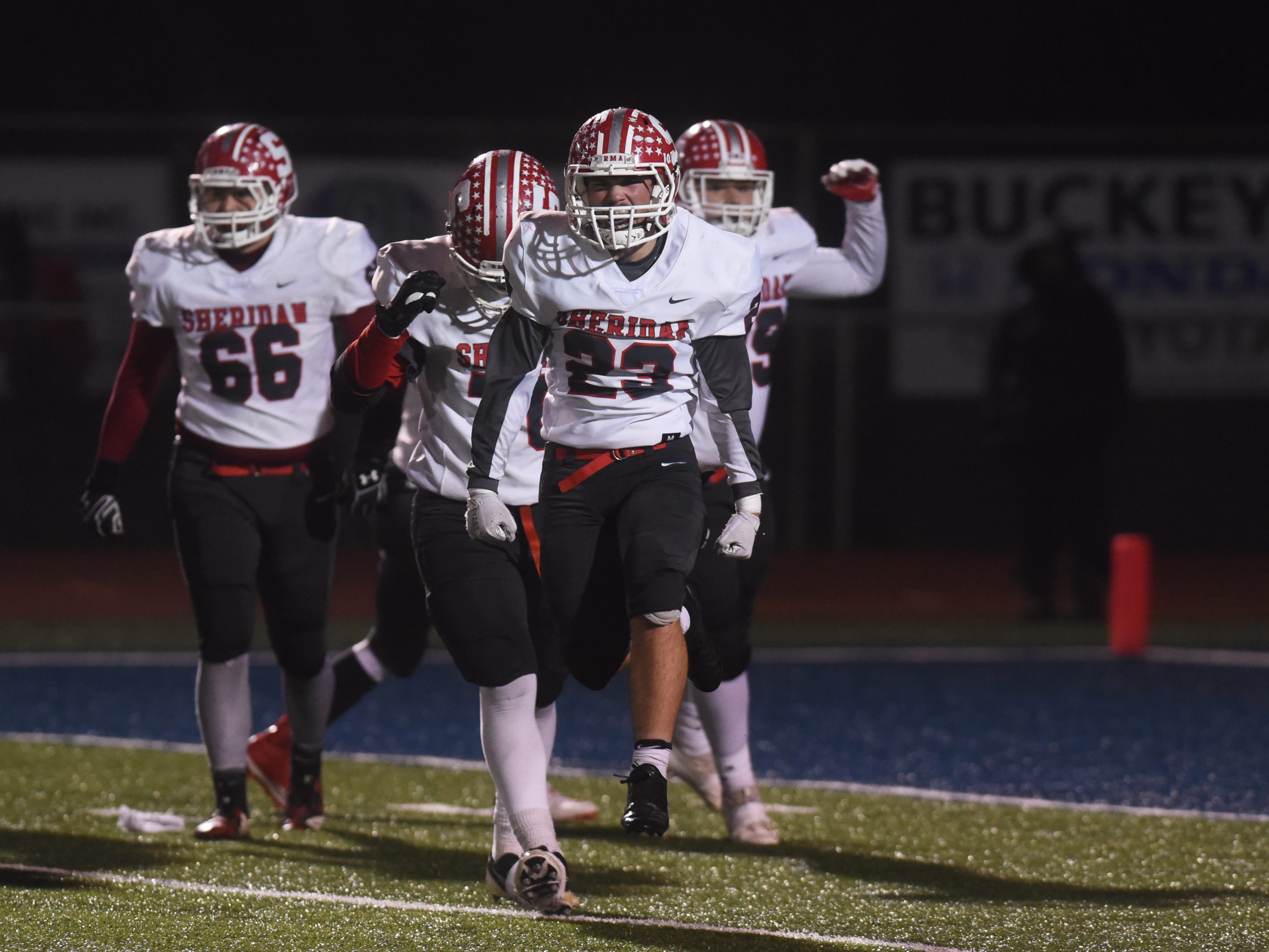Sheridan celebrates a goal-line stand as the first half ends against Columbus Eastmoor Academy in a Division III, Region 11 final on Friday night in Lancaster. Sheridan lost, 20-14, to cap an 11-2 season.