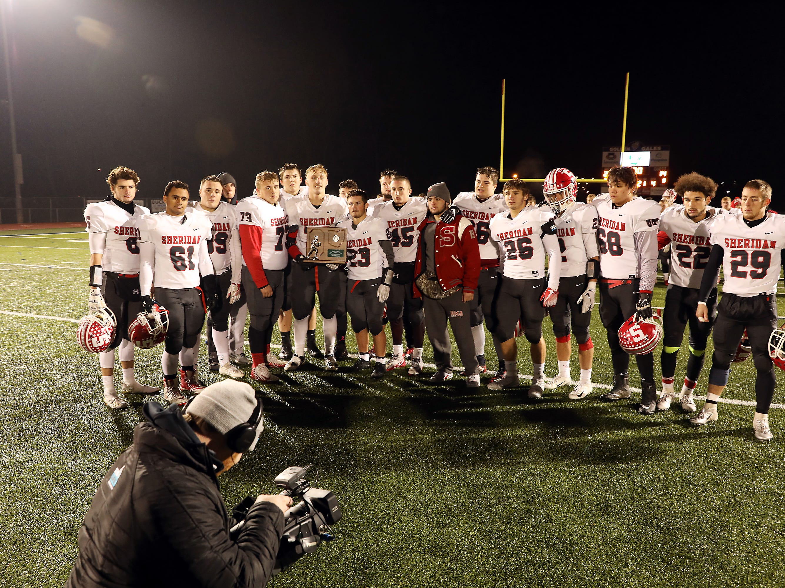 The Sheridan seniors pose for a picture after falling to Eastmoor.