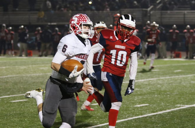 Sheridan's Ethan Heller heads toward the end zone against Eastmoor Academy in the regional finals earlier this month. Heller set several school records on his way to earning the Division III player of the year award, as the All-Ohio Division II and III teams were released on Tuesday.