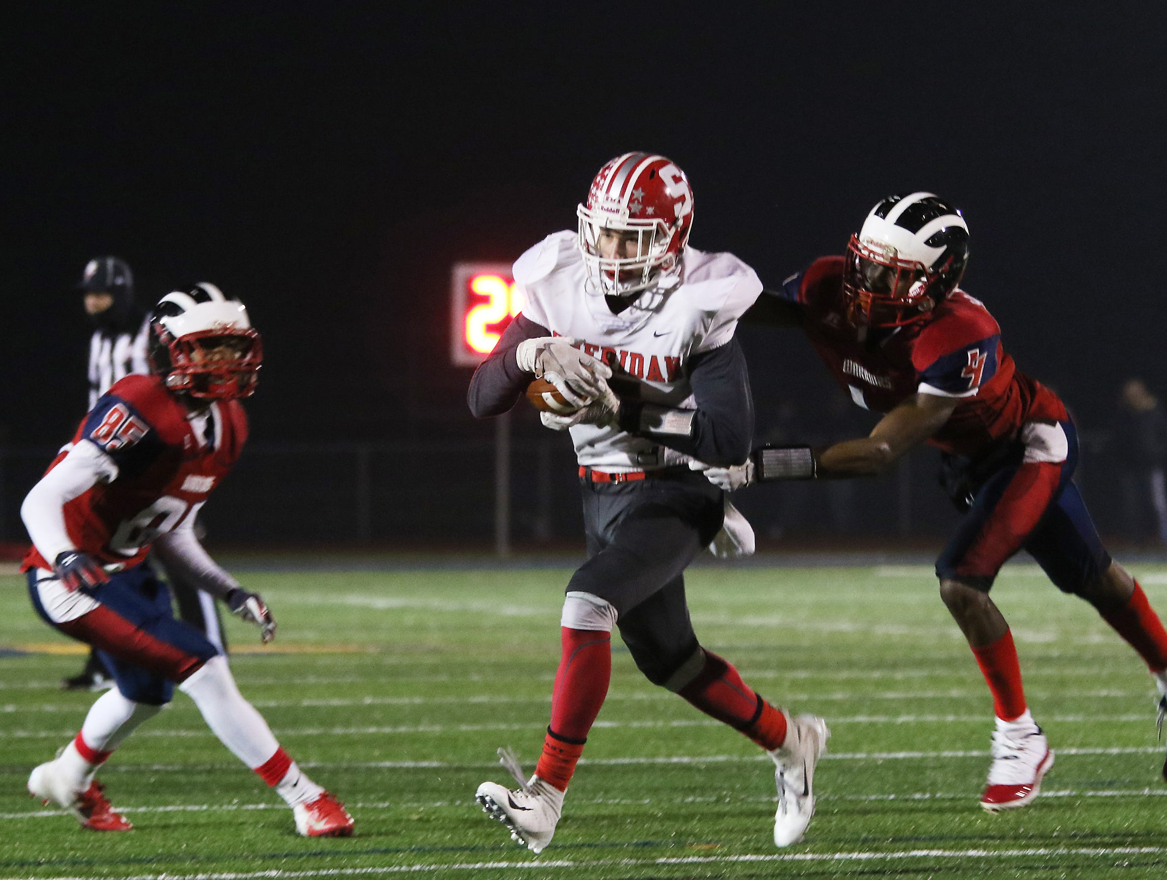 A Sheridan receiver pulls in a pass against Eastmoor.