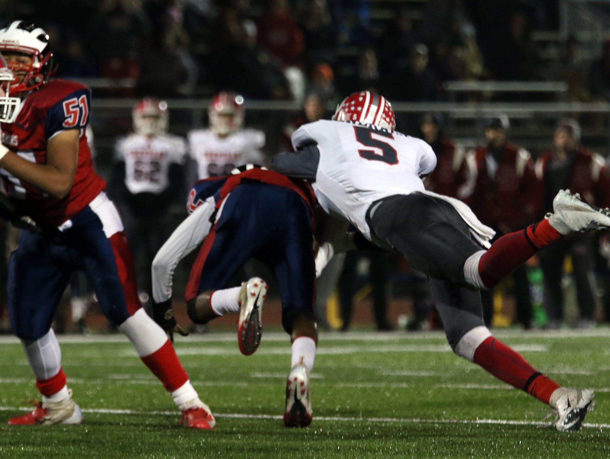Sheridan's Shay Taylor sacks Eastmoor's quarterback.