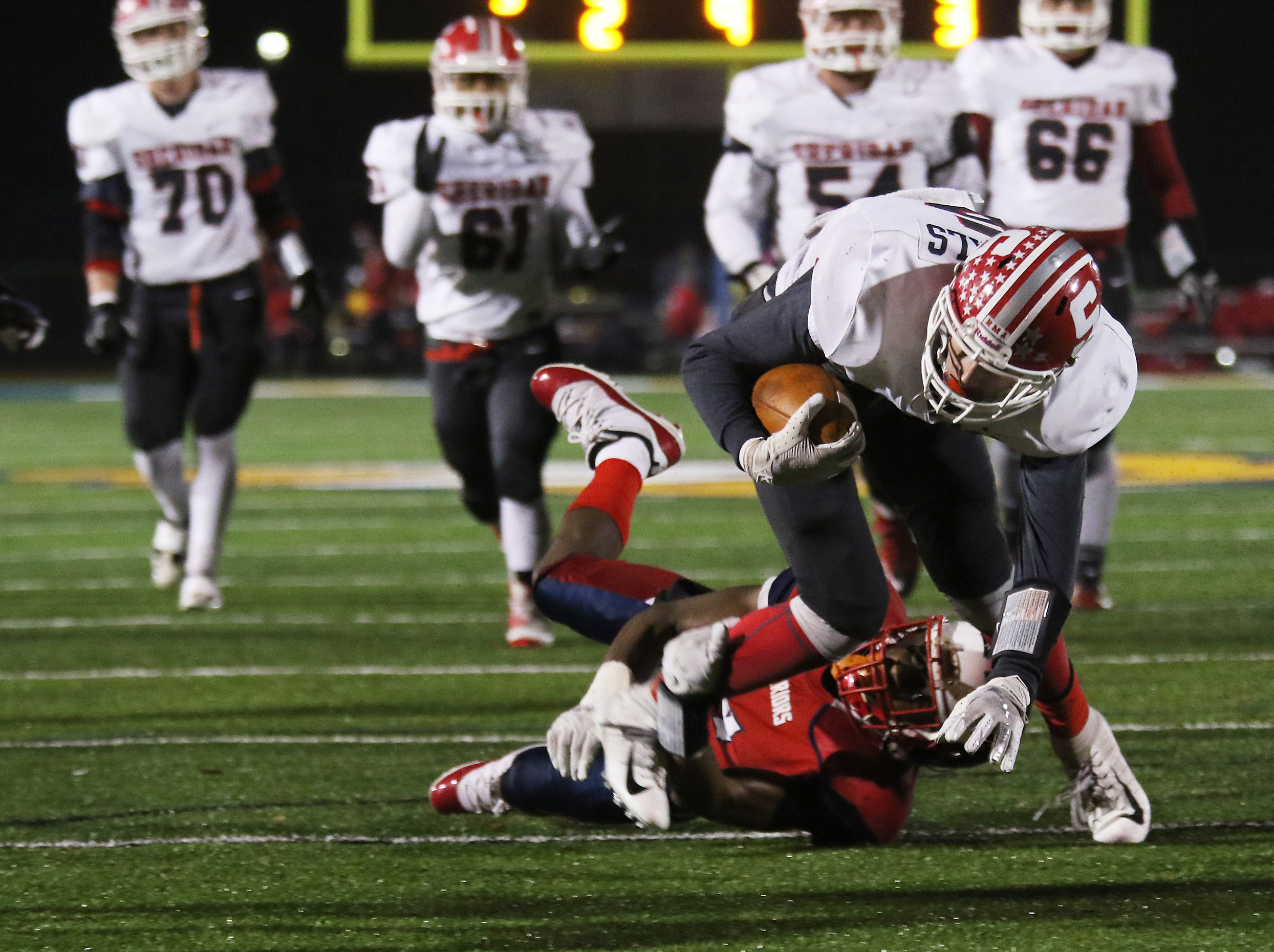 A Sheridan receiver lunges for extra yardage against Eastmoor.
