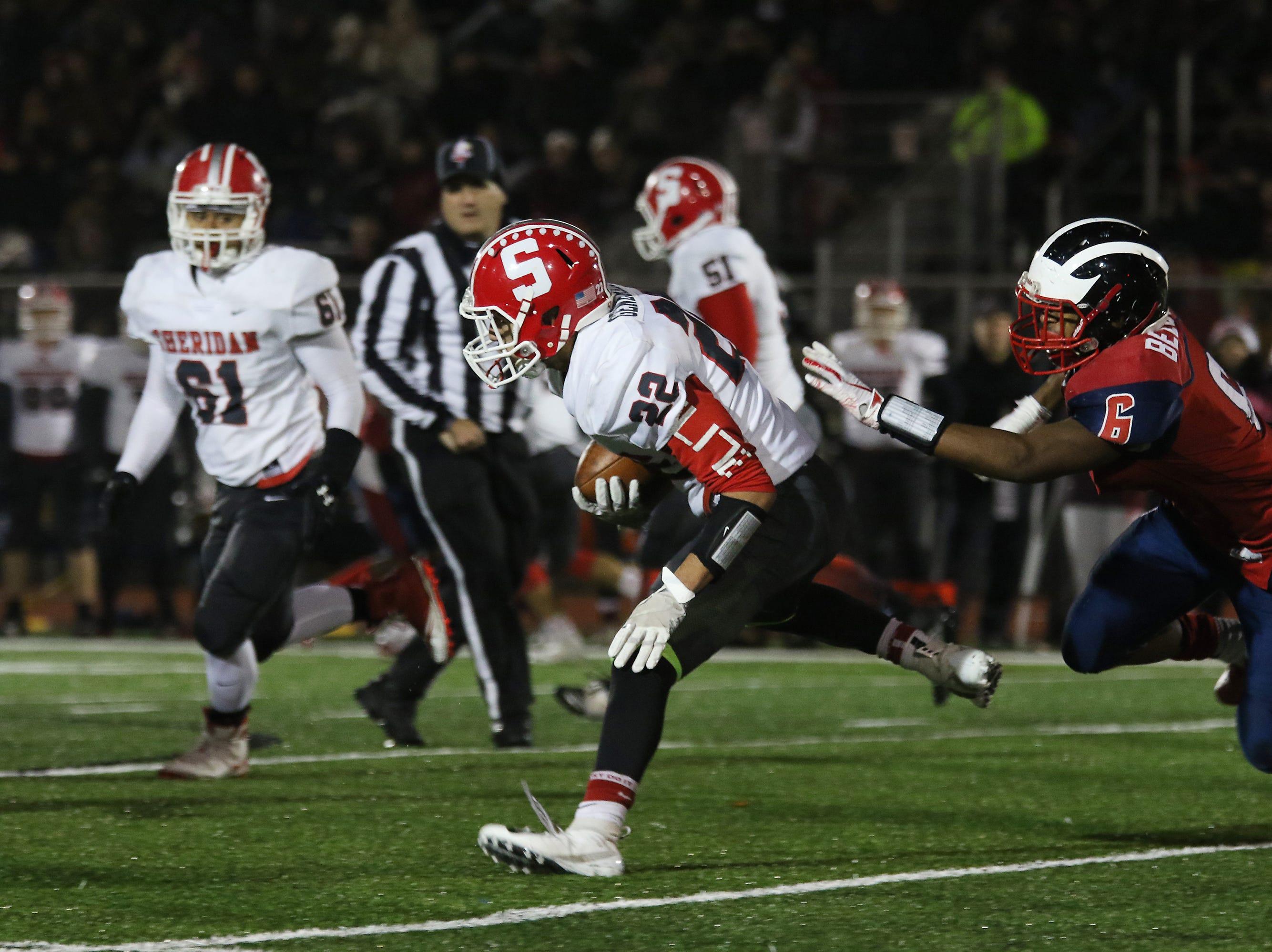 Sheridan's Isaiah Austin carries the ball against Eastmoor.