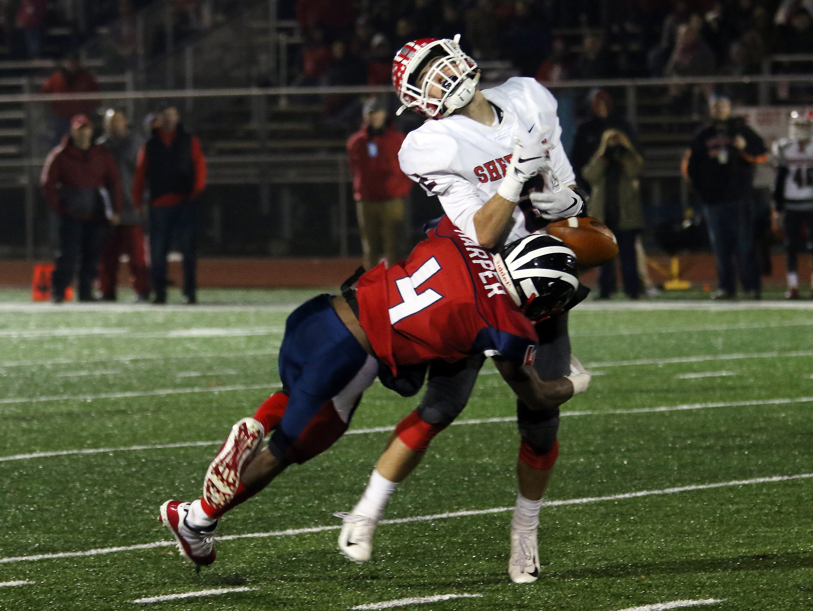 Sheridan's Cole Casto gets hit by an Eastmoor defender.