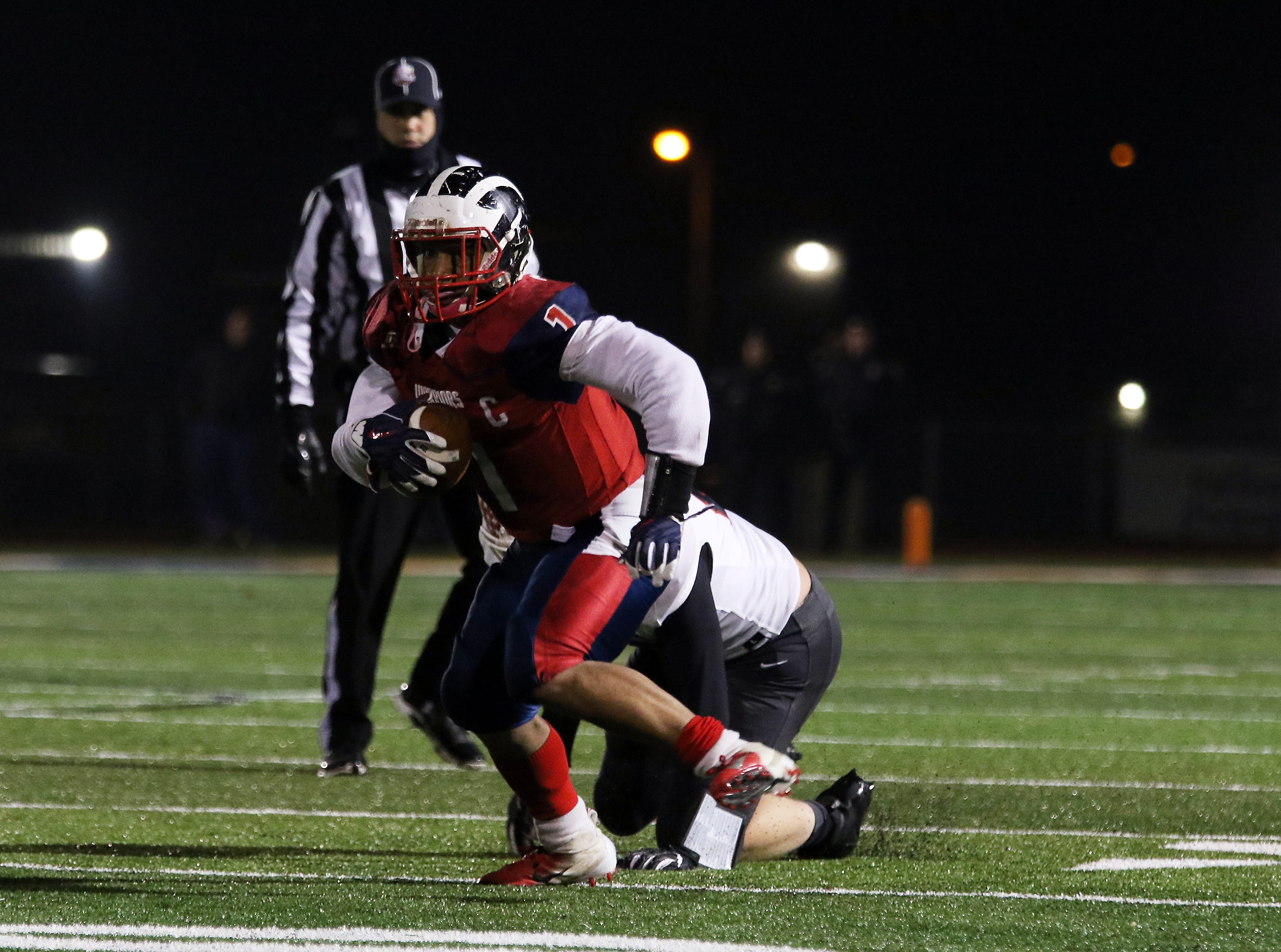 Sheridan's Adam Boyle tries to tackle an Eastmoor ball carrier.