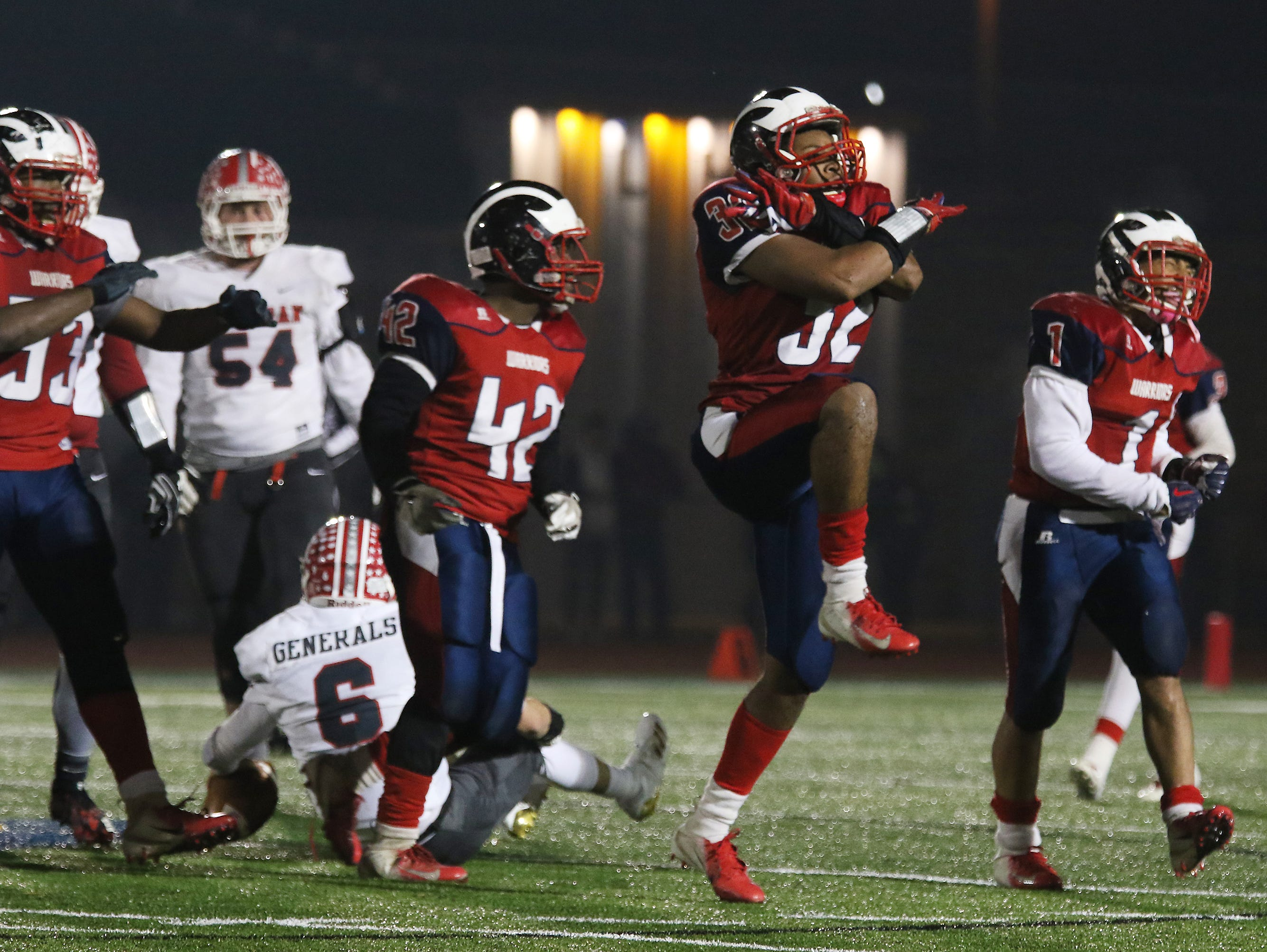An Eastmoor player celebrates after sacking Sheridan's Ethan Heller.