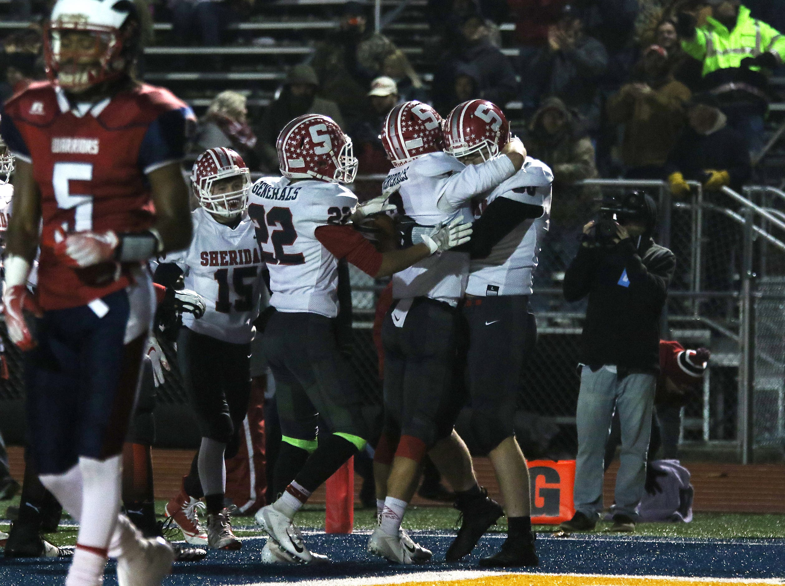 Sheridan's Adam Boyle gets a hug from Ethan Heller after Boyle's touchdown catch against Eastmoor.