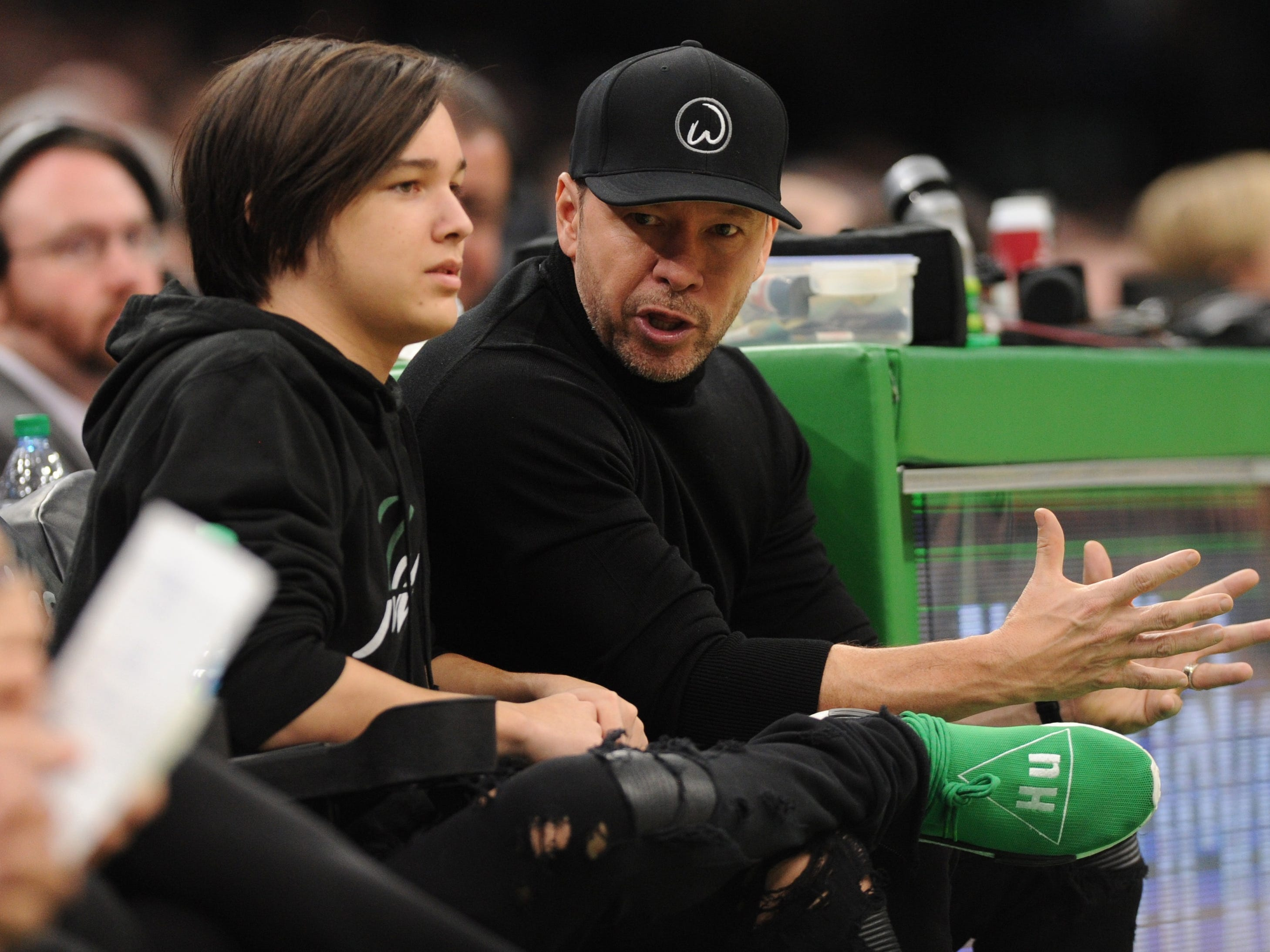 Nov. 16: Actor Donnie Wahlburg and his son Elijah take in the Celtics-Raptors game at TD Garden in Boston.