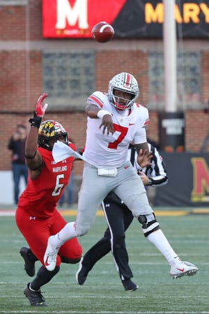 Ohio State Buckeyes quarterback Dwayne Haskins (7) threw for three touchdowns and ran for three Saturday against Maryland.