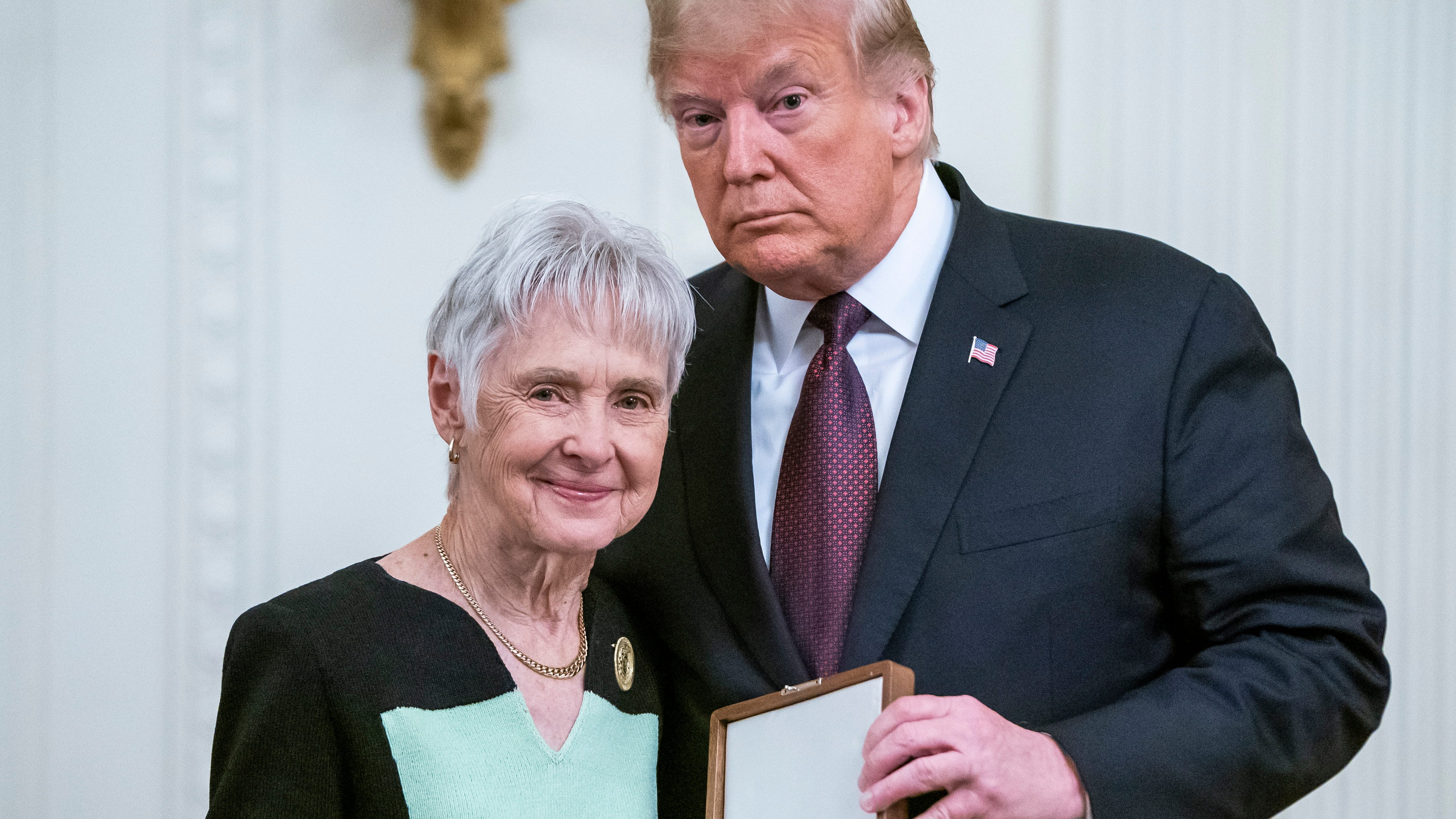 President Donald Trump is pictured awarding the Presidential Medal of Freedom to former Supreme Court Justice Antonin Scalia's widow Maureen Scalia at the White House.