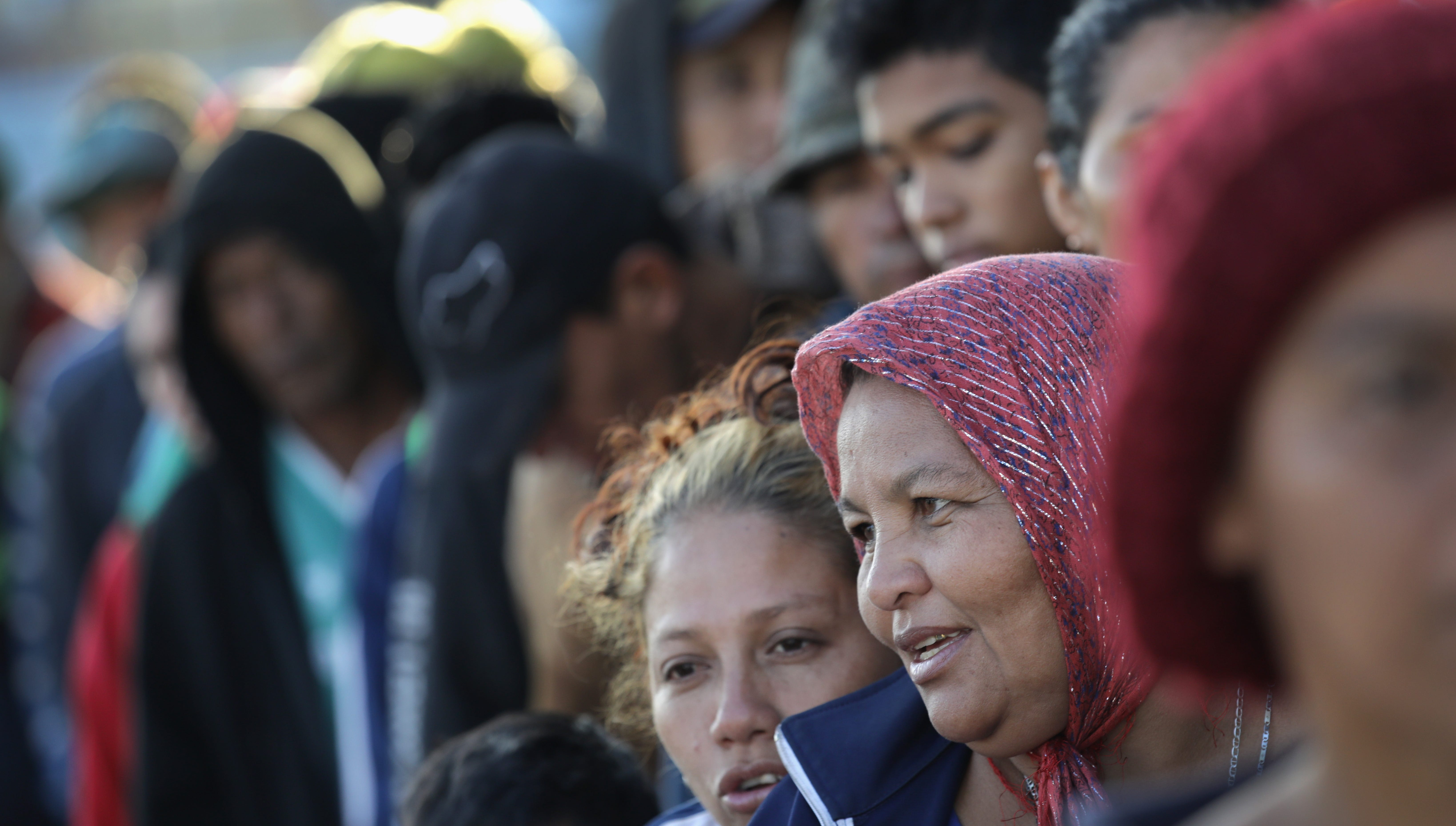 Members of the migrant caravan wait in line to turn in requests for political asylum at the U.S.-Mexico border on Nov. 17, 2018 in Tijuana, Mexico.