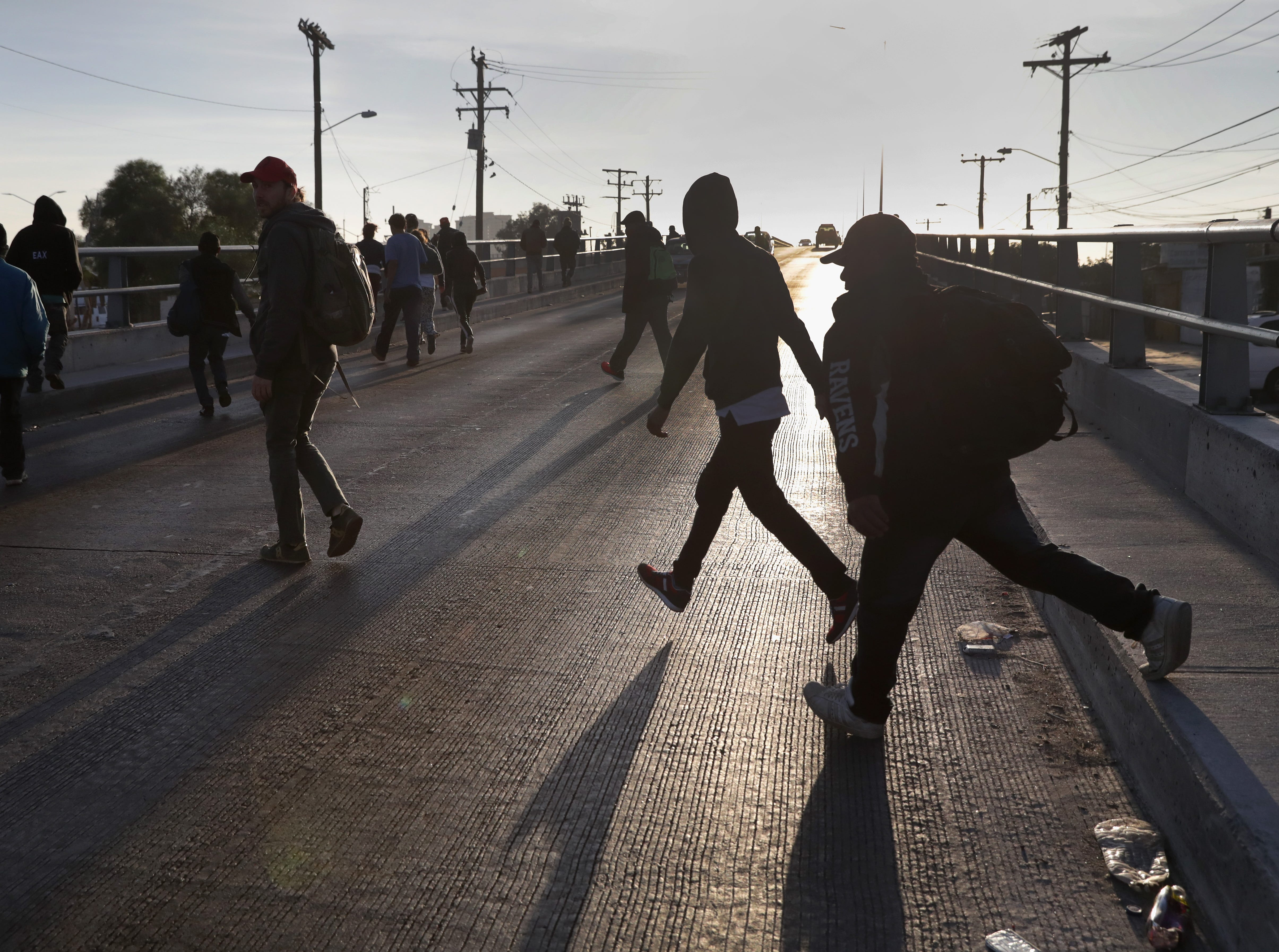 Members of the migrant caravan walk to make requests for political asylum at the U.S.-Mexico border on Nov.17, 2018 in Tijuana, Mexico.