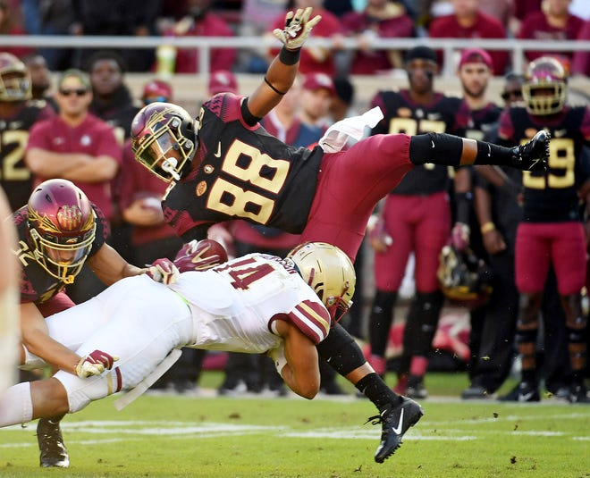 Florida State Seminoles wide receiver Tre'Shaun Harrison is tackled by Boston College Eagles linebacker Max Richardson.