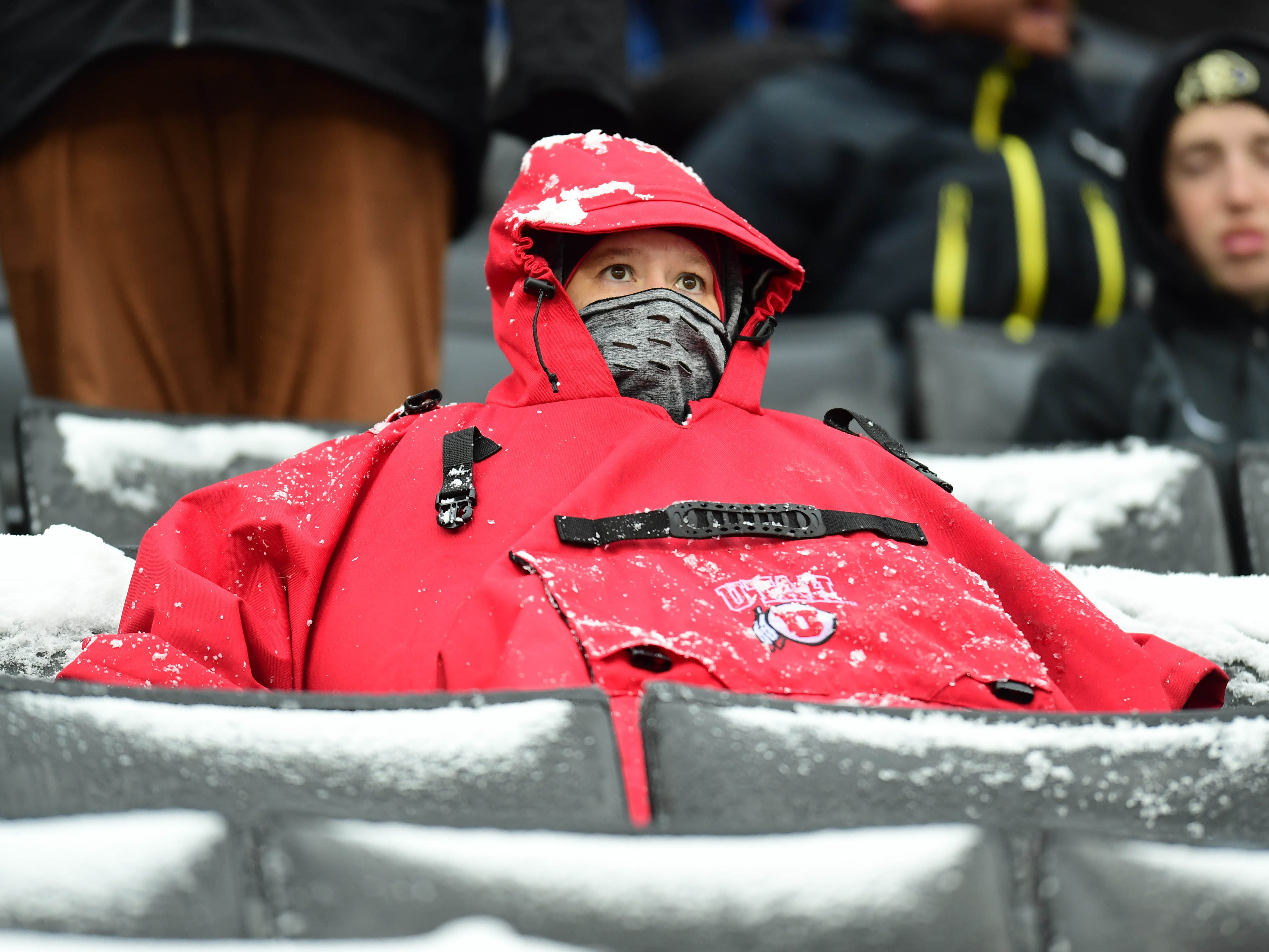 Week 12: A Utah Utes fan bundles up during the game against the Colorado Buffaloes.