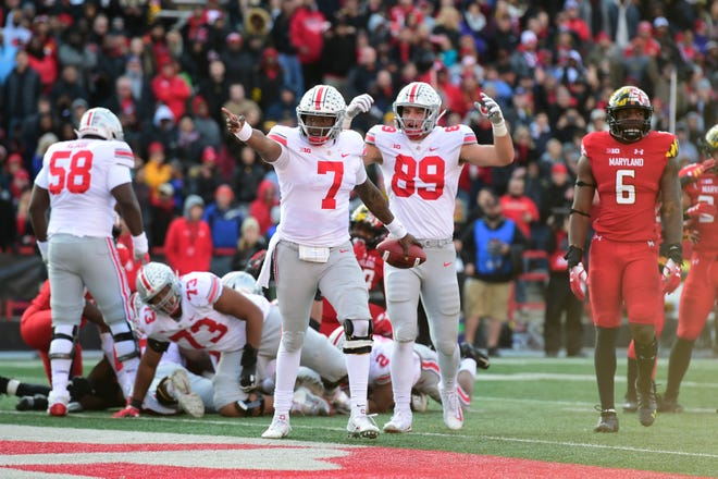 Ohio State quarterback Dwayne Haskins (7) celebrates after scoring a touchdown against Maryland.