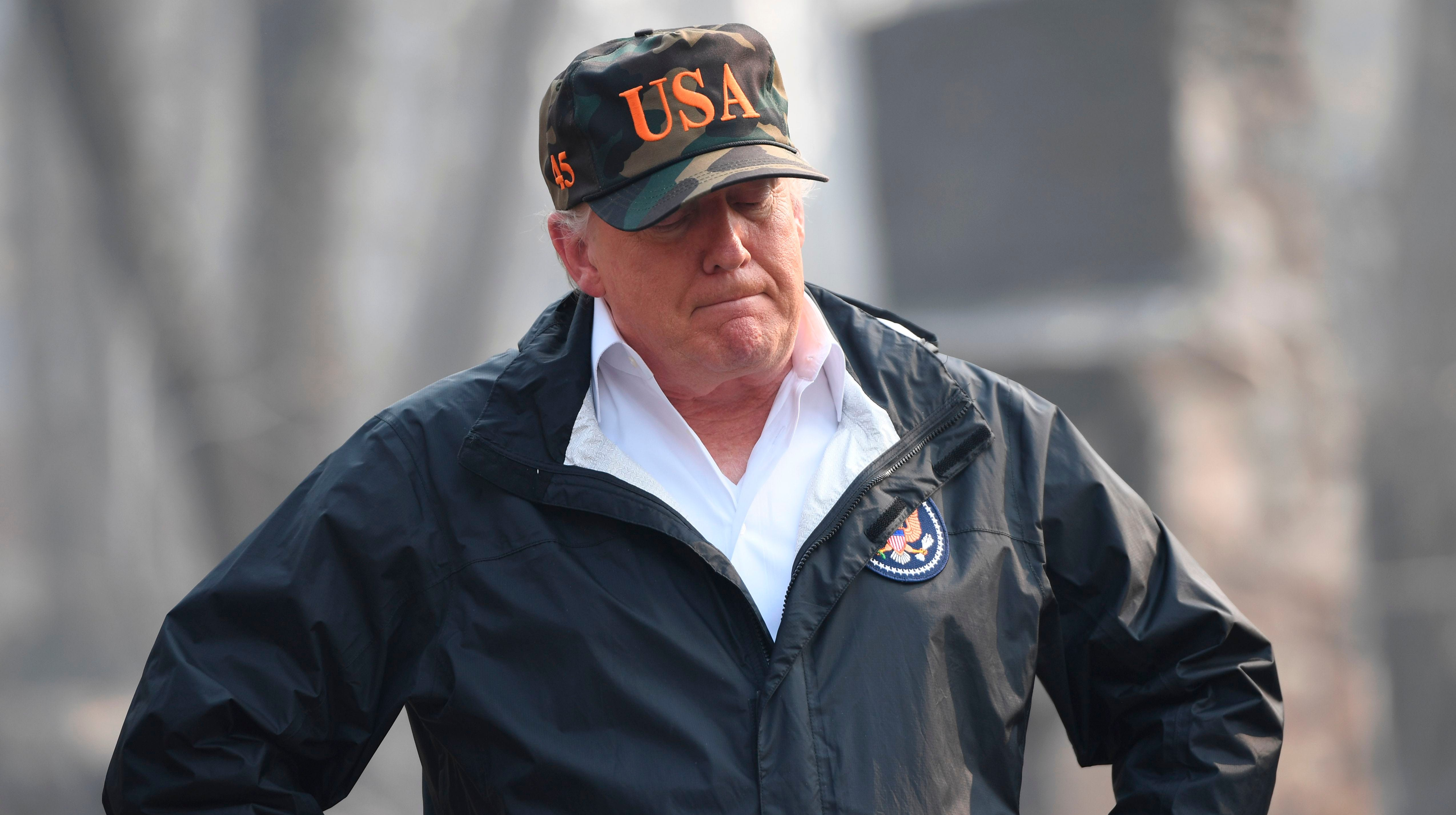 President Donald Trump looks on as he views damage from wildfires in Paradise, California on Nov. 17, 2018.