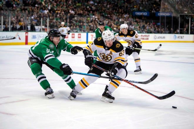 Boston Bruins winger Brad Marchand (63) had another eventful game Friday night against the Dallas Stars.