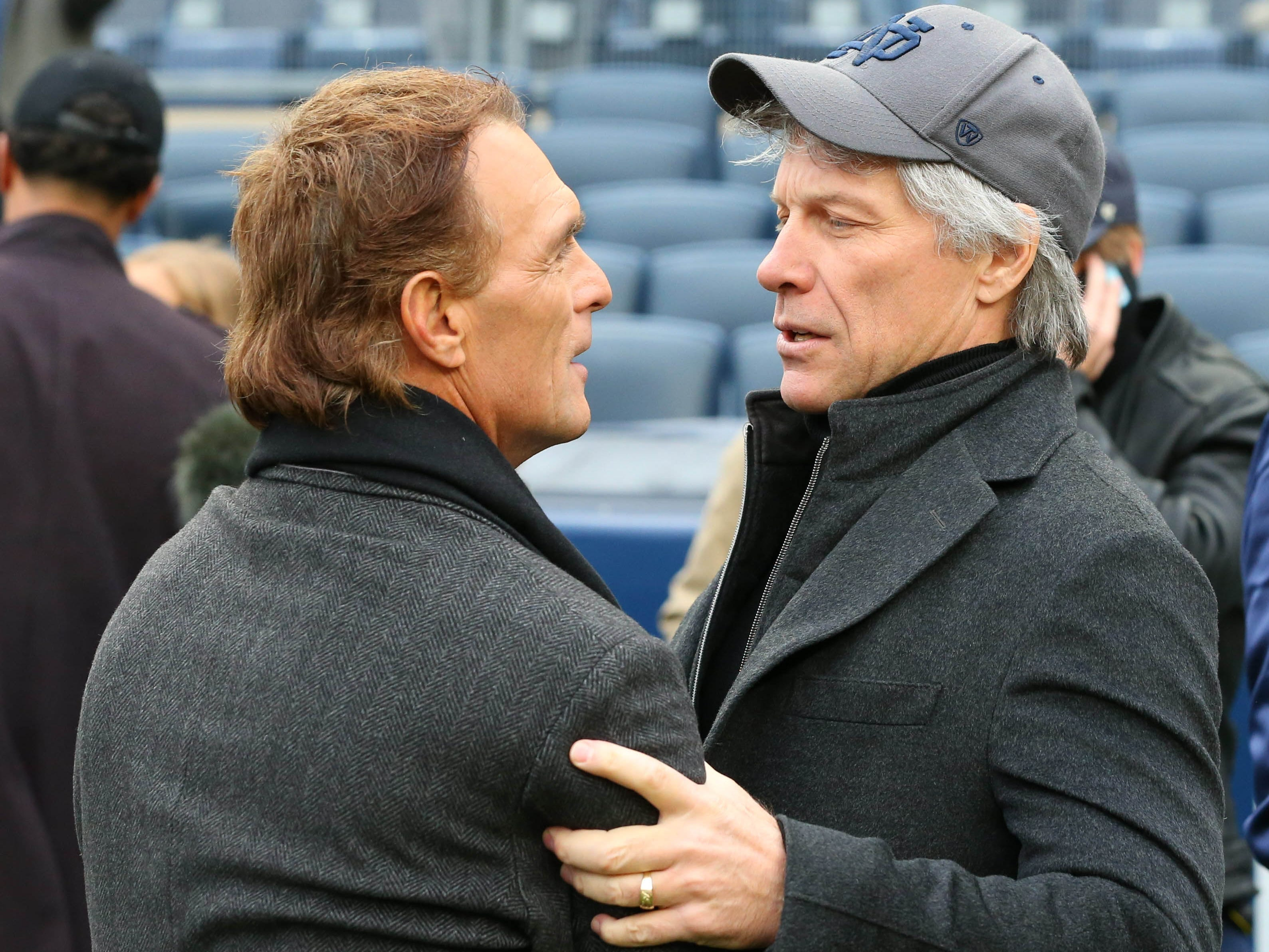 Week 12: Former NFL quarterback Doug Flutie (left) and recording artist Jon Bon Jovi (right) talk prior to the game between the Notre Dame Fighting Irish and the Syracuse Orange at Yankee Stadium.