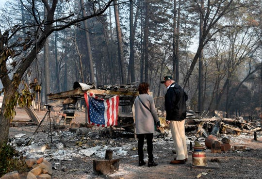 President Donald Trump views damage from wildfires in Paradise, California on November 17, 2018.