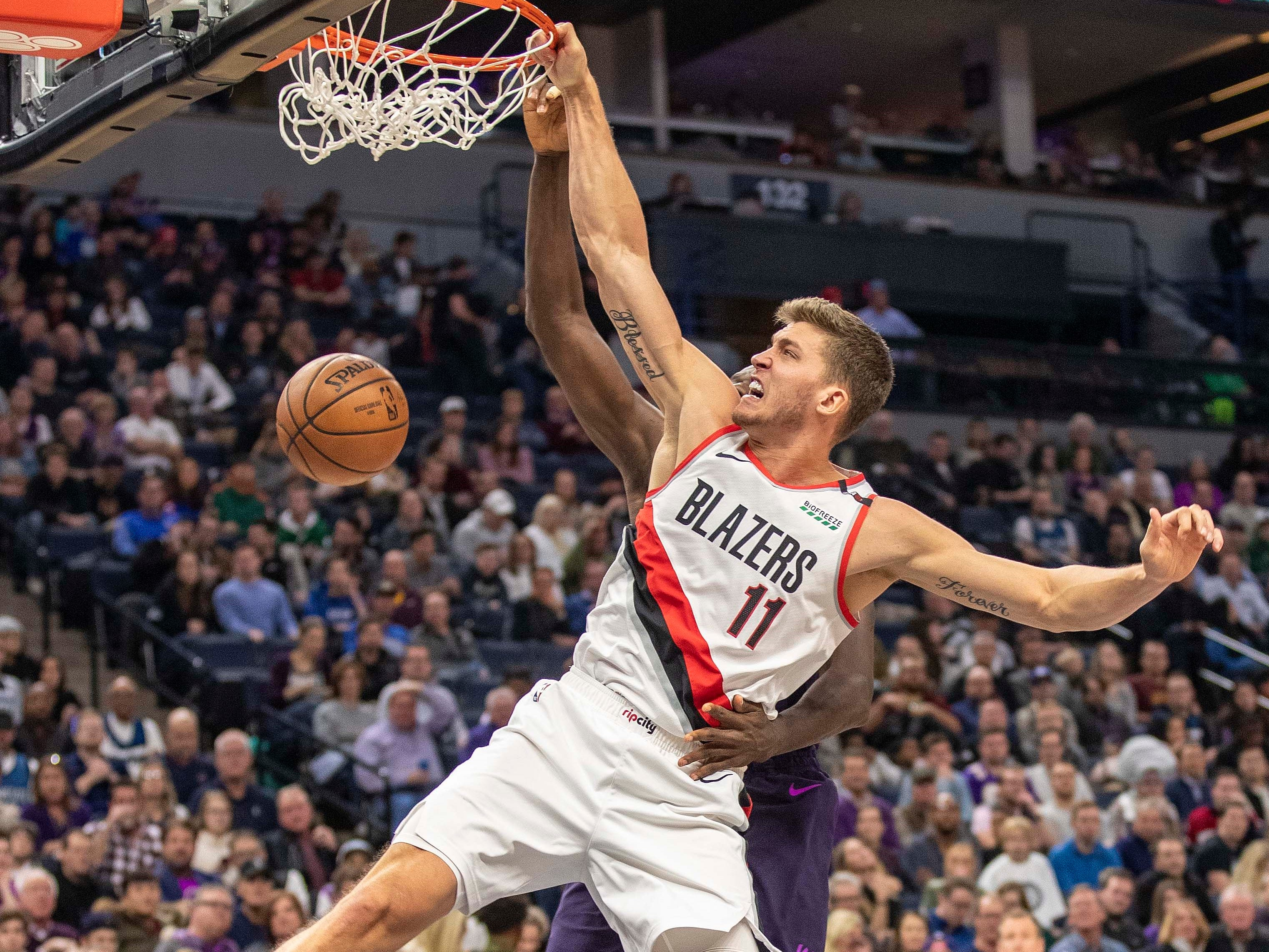 Nov. 16: Blazers forward Meyers Leonard (11) throws down a one-handed slam against Timberwolves center Gorgui Dieng (5) during the second half in Minneapolis.
