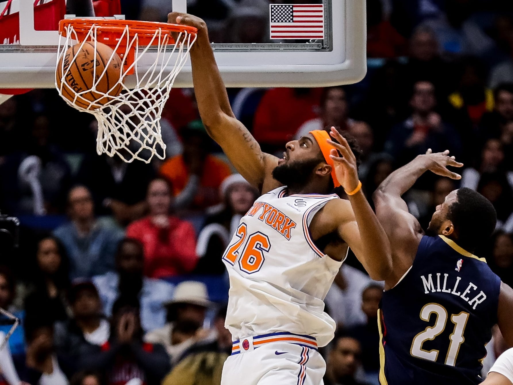 Nov. 16: Knicks center Mitchell Robinson (26) finishes a one-handed flsuh against Pelicans defender Darius Miller (21) during the second half in New Orleans.