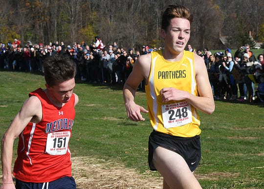 Point Pleasant Boro's Devin Hart battles Mendham's Jack Stanley at the finish line. Hart won by a fraction of a second at the Cross Country Meet of Champions at Holmdel Park